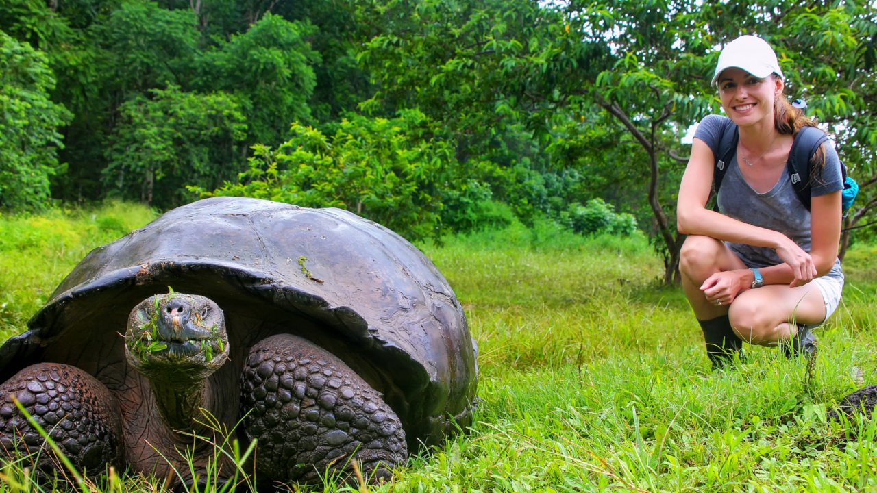 woman with giant tortoise galapagos