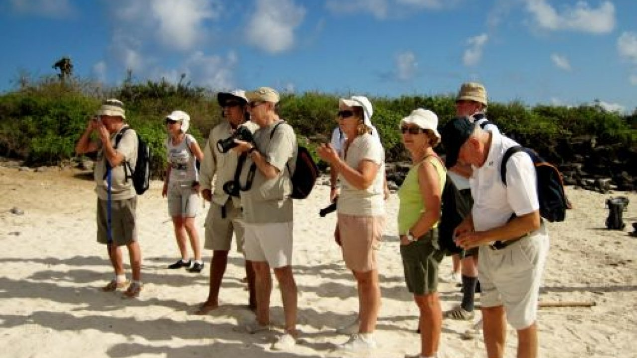 People on beach in Galapagos