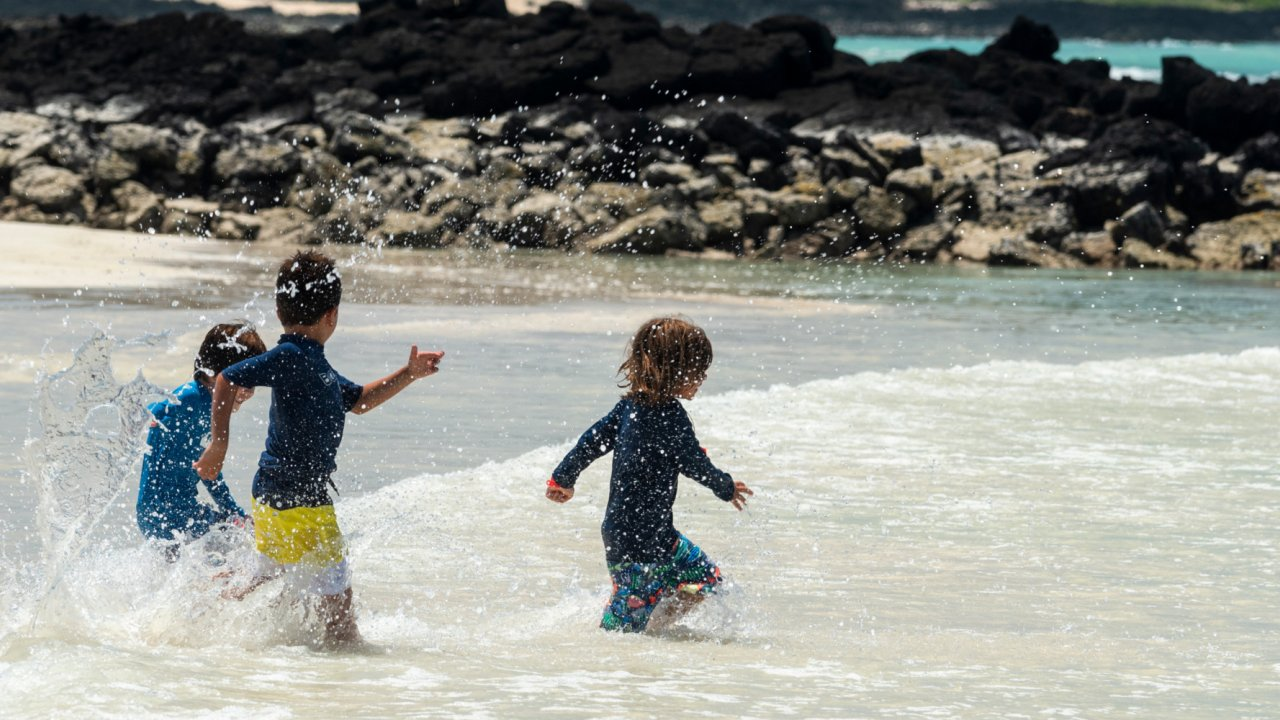 kids playing on galapagos beach