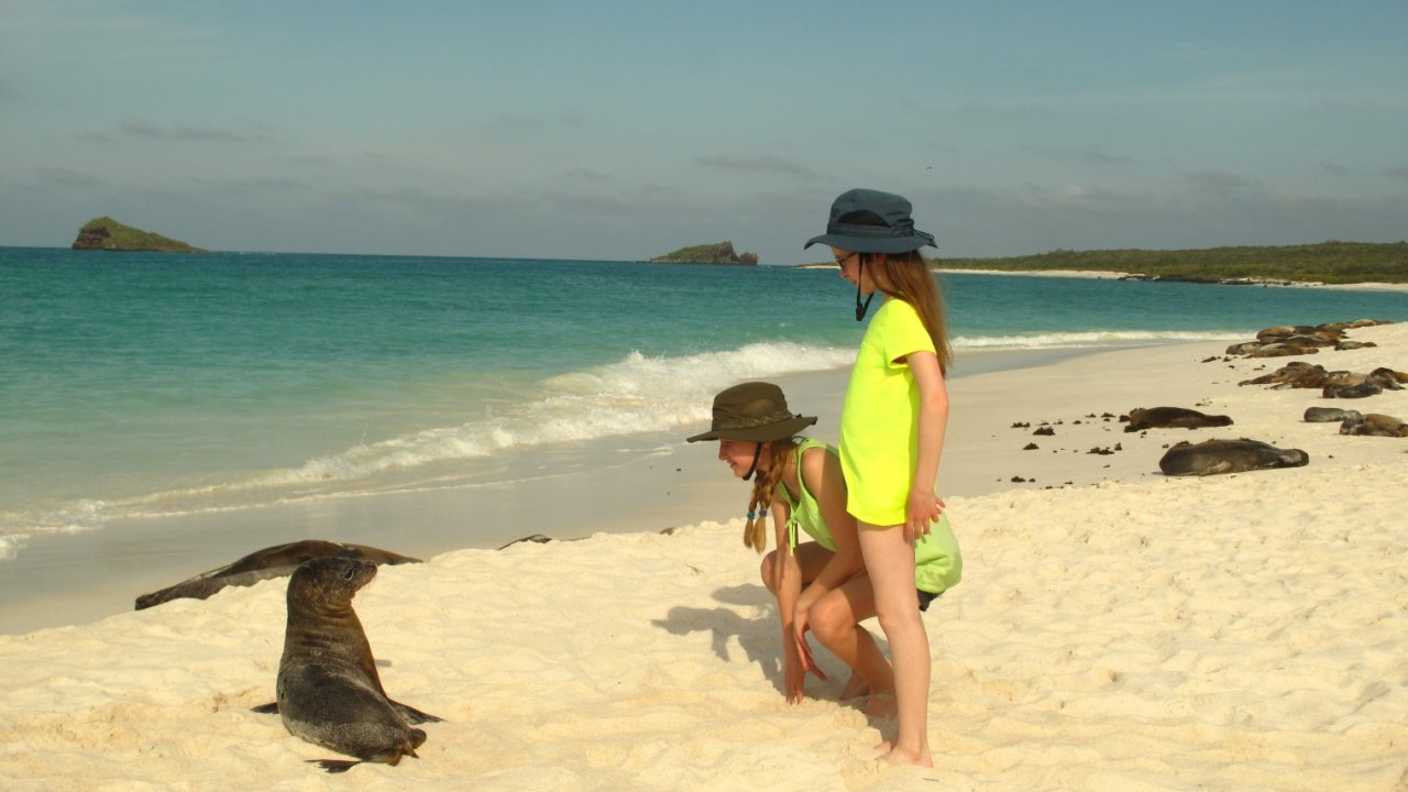 kids playing on galapagos beach