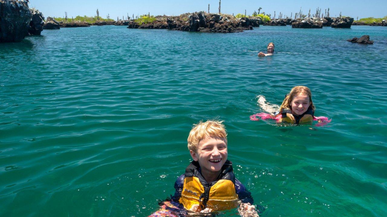kids swimming galapagos