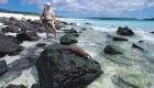 man on beach galapagos